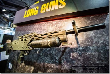 shot-show-2013-keltech-shotgun-eotech-optic-red-dot-flip-to-side-magnifier-air-gun-full-auto (1)